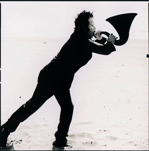 Tom Waits blows a horn