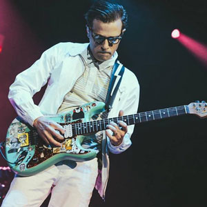 Photo of Weezer guitar Player